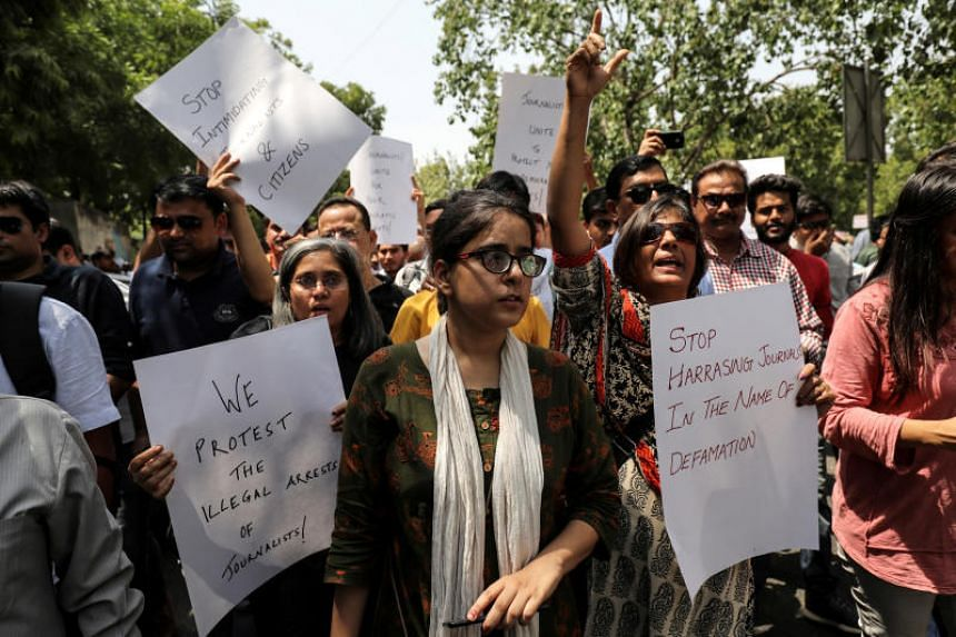 Jagisha Arora (centre), wife of Prashant Kanojia, taking part in a protest with media members in New Delhi on June 10, 2019.