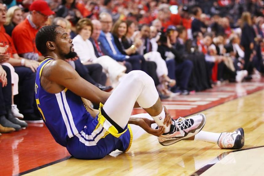 Kevin Durant of the Golden State Warriors reacts after sustaining an injury during the second quarter against the Toronto Raptors during Game Five of the 2019 NBA Finals at Scotiabank Arena on June 10, 2019 in Toronto, Canada.