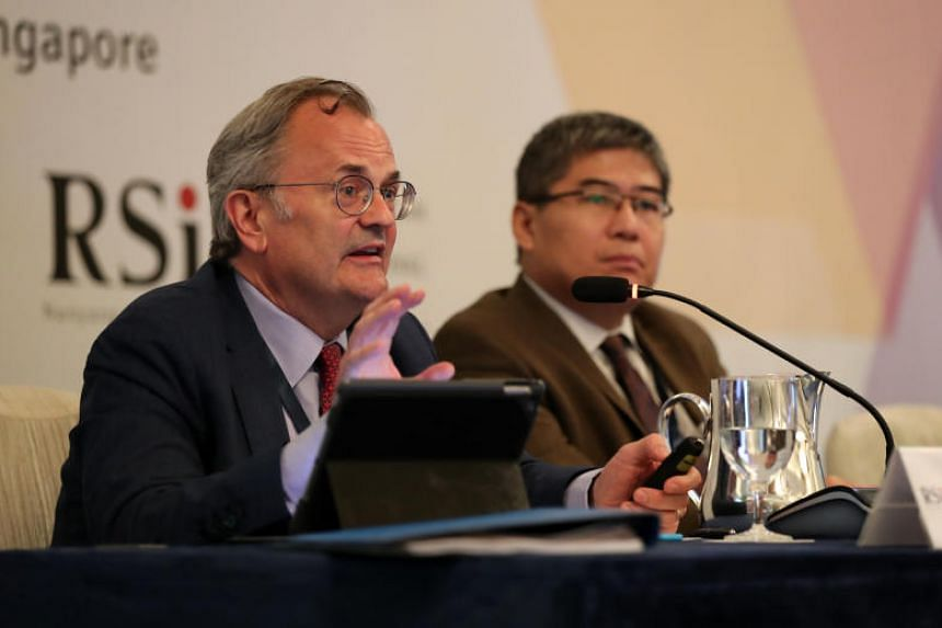 Mr Keith Rockwell (left), WTO's director for information and external relations, and Dr Henry Gao, Associate Professor, School of Law, Singapore Management University at the workshop on June 11, 2019.