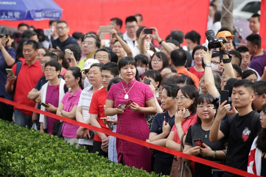 "Parents and relatives are seen as students arrive at the High School affiliated to Renmin University of China for the first part of China's annual national college entrance exam, or ""gaokao"", in Beijing on June 7, 2019."