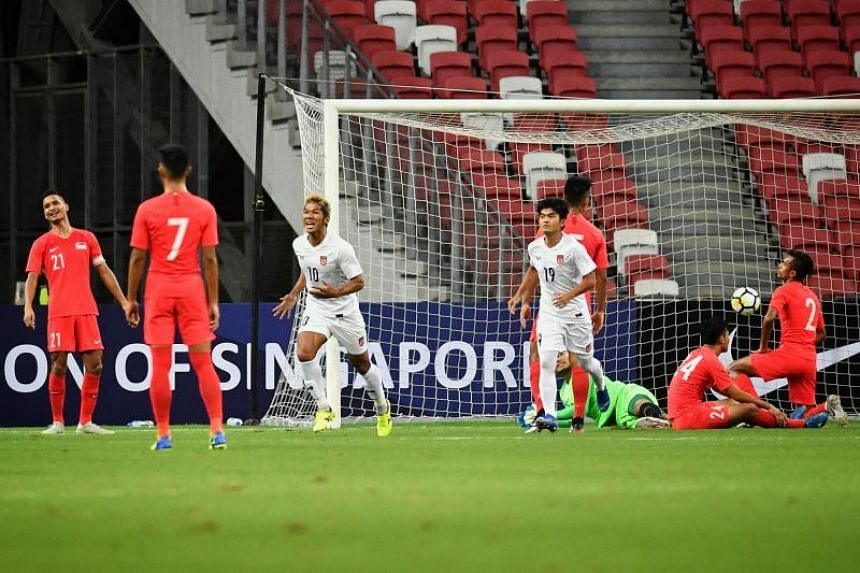 Kyaw Ko Ko celebrates after scoring the first goal for Myanmar in the international friendly match between Singapore and Myanmar at the National Stadium on June 11, 2019.