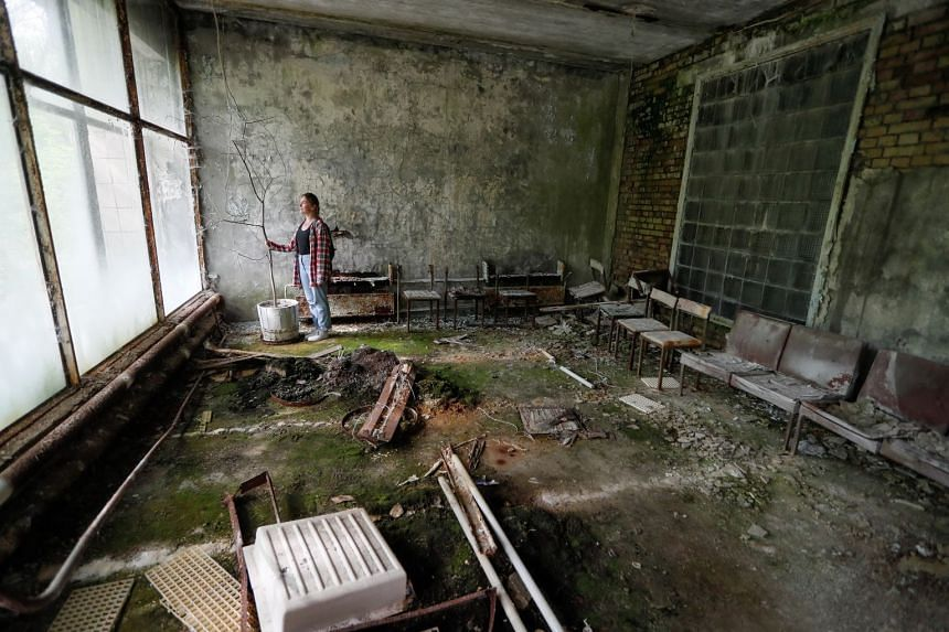 A visitor in the abandoned hospital which received the first causalities of the Chernobyl accident.