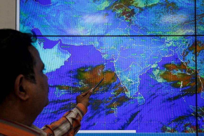 A scientist with the India Meteorological Department monitors Cyclone Vayu at his office in Ahmedabad, India.