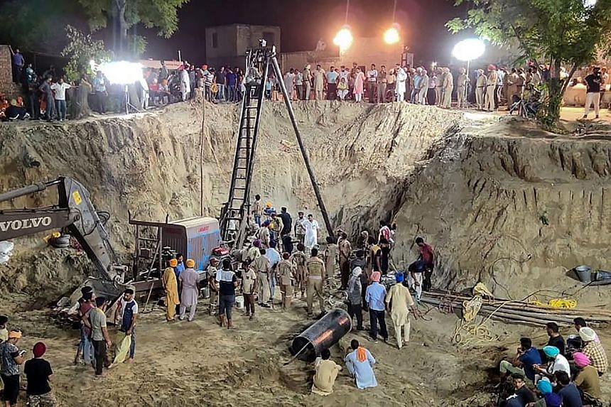 An Indian rescue team trying to save the boy from the well, which was just 23cm wide, on Monday in the Punjab district of Sangrur.