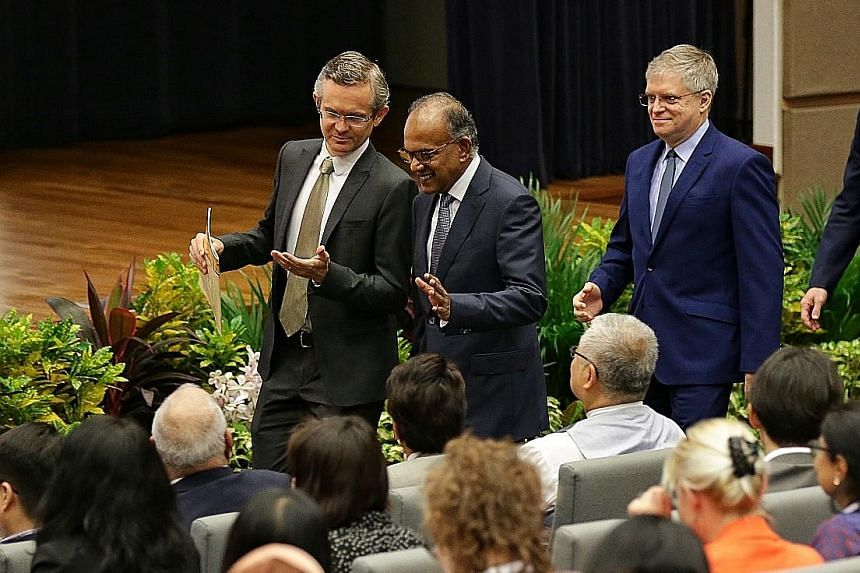Minister for Home Affairs and Law K. Shanmugam, with dean of NUS Law Simon Chesterman (left) and director of the Asian Law Institute Gary F. Bell, arriving for the opening of the 16th Asian Law Institute Conference in NUS' Bukit Timah campus yesterda