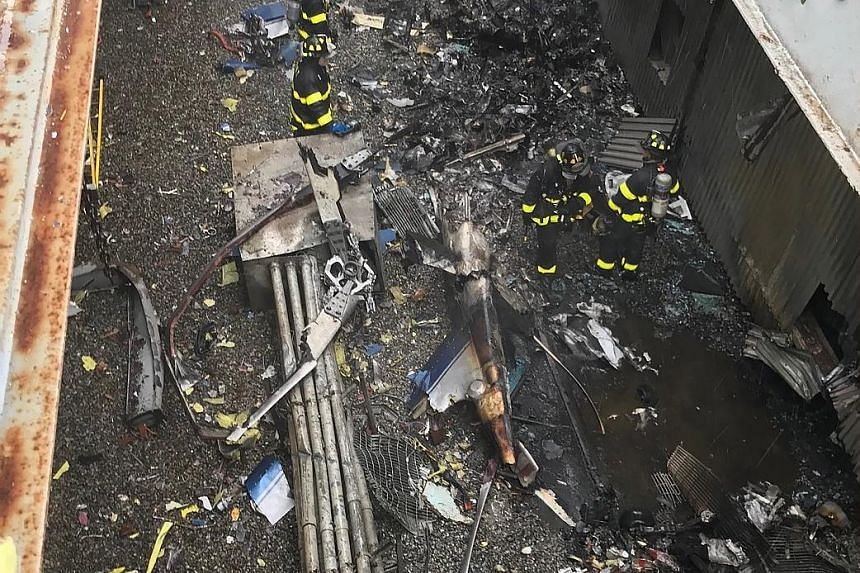 New York City firefighters working at the scene of a helicopter crash on the roof of the Equitable Building in Manhattan, New York, on Monday. New York Governor Andrew Cuomo said there was no indication of the crash being intentional.