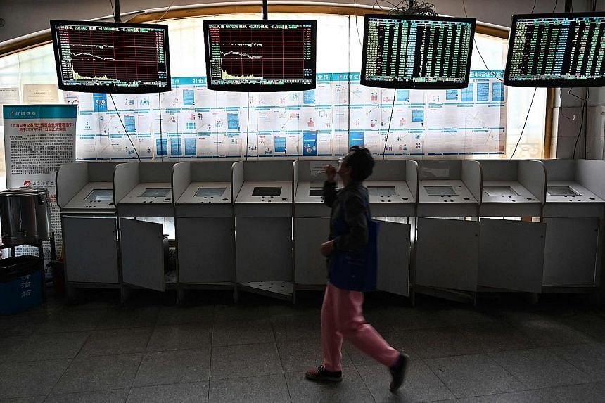 An investor checking stock price movements at a securities company in Shanghai. Chinese firms and investors are lining up to take part in Shanghai's new Nasdaq-style tech board, with a groundswell of patriotic support surging further after the US' bl