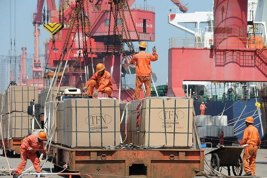 Workers loading goods for export onto a crane at a port in Jiangsu province in China. The WTO saw 24 dispute settlement cases last year specifically related to the US-China trade war - on issues like intellectual property - said WTO director for info