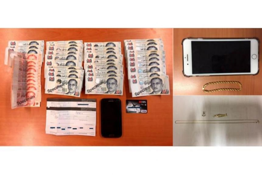 Two mobile phones, some bank-related documents, several pieces of jewellery and $1,750 in cash were seized.