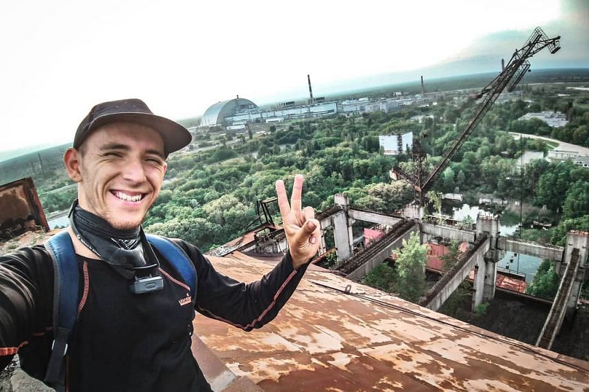 A Chernobyl tourist takes a selfie for his Instagram page.