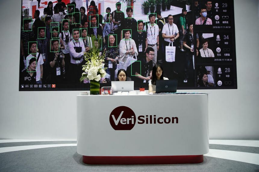 Visitors seen on a screen displaying facial recognition technology at CES Asia 2019 in Shanghai on June 11, 2019.