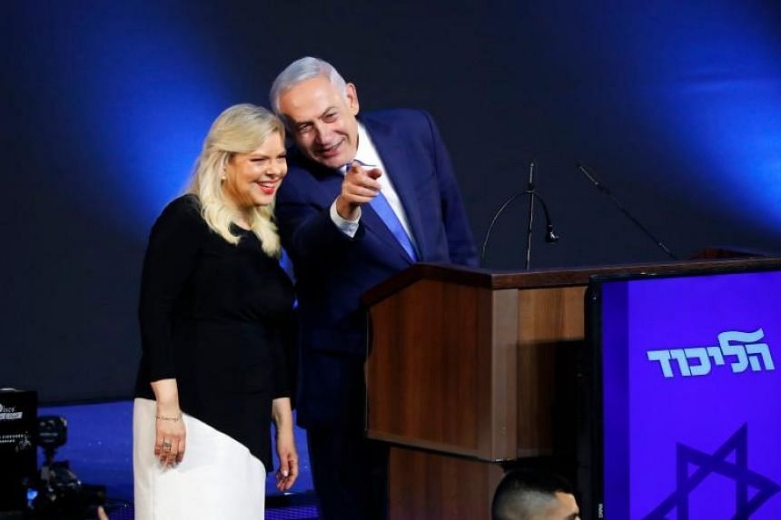 Israeli Prime Minister Benjamin Netanyahu and his wife Sara at Mr Netanyahu's Likud Party headquarters in Tel Aviv on election night on April 10, 2019. Mrs Netanyahu has signed a plea bargain over allegedly misusing state funds to order gourmet meals