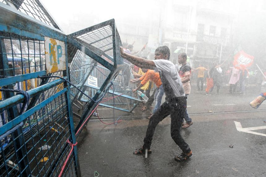 Police use water cannon to disperse supporters of India's Bharatiya Janata Party during a protest against what they call violence against their party workers in the state of in Kolkata on June 12, 2019.