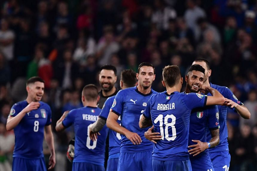 Italy's players celebrate at the end of the match.
