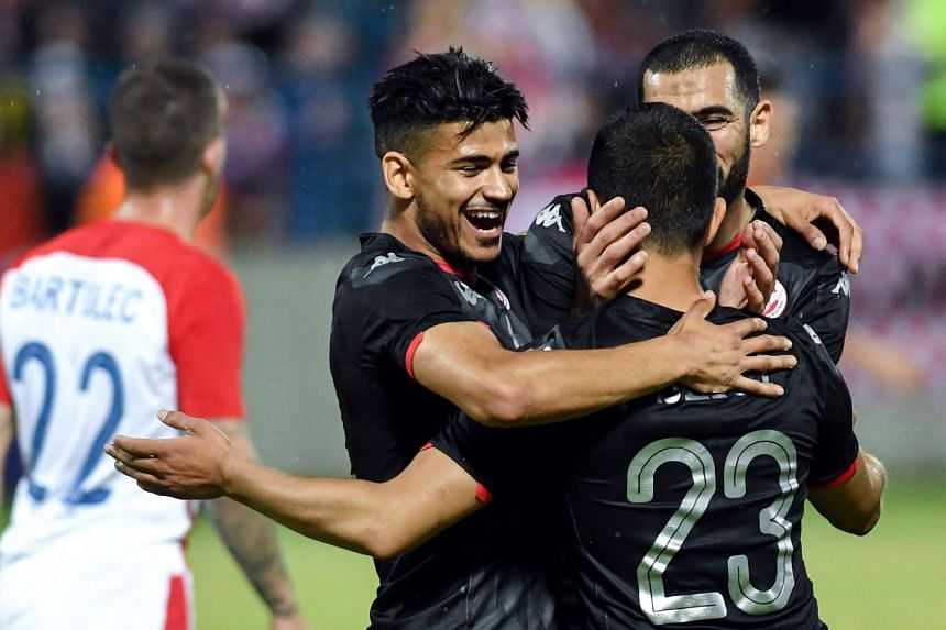 Tunisia's players celebrate after scoring a second goal.