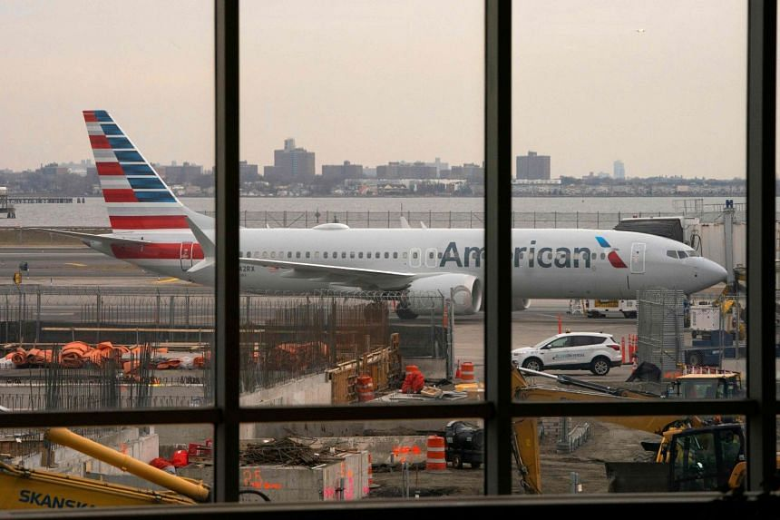 An American Airlines 737 Max sits at the gate at LaGuardia airport in New York.in March 2019.