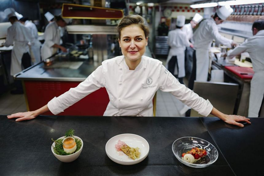 Prealpato of the Plaza Athenee hotel poses for a portrait in her restaurant's kitchen.