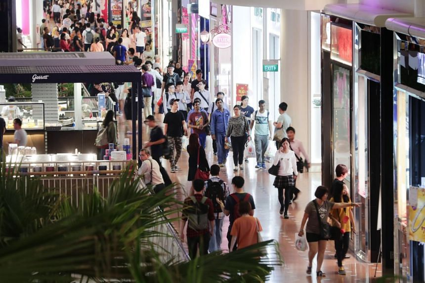 Shoppers at Jurong Point, on Feb 18, 2019. Excluding motor vehicles, retail sales dropped 2 per cent year on year.
