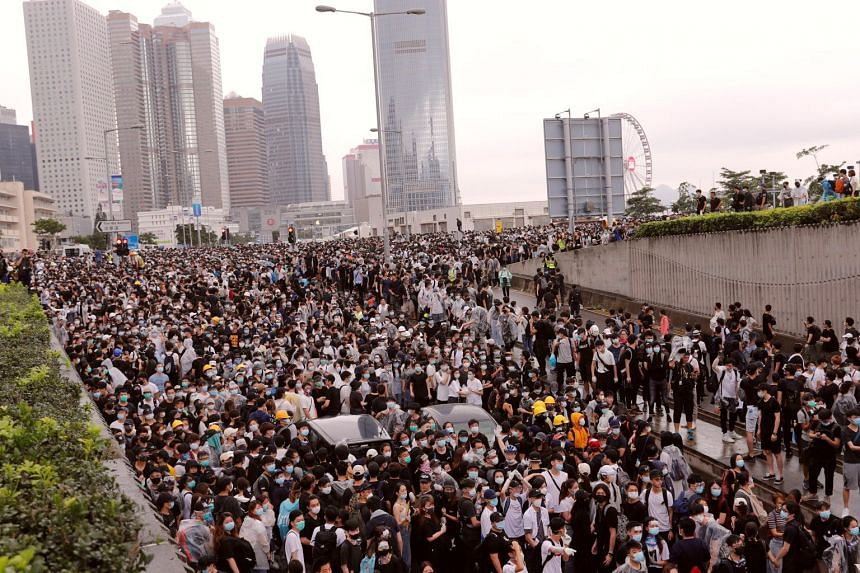 Protesters rally against a proposed extradition Bill in Hong Kong, on June 12, 2019.