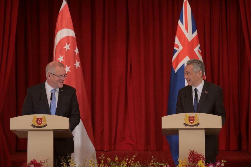 Australia's Prime Minister Scott Morrison shakes hands with Prime Minister Lee Hsien Loong at the Istana in Singapore, on June 7, 2019.