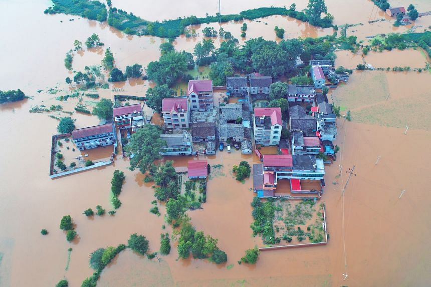 Homes submerged in floodwaters following heavy rainfall in Taihe county, Jiangxi province, on Monday. Thousands were stranded amid torrential rain across central and southern China, with floods wiping out 10,800ha of crops and destroying hundreds of