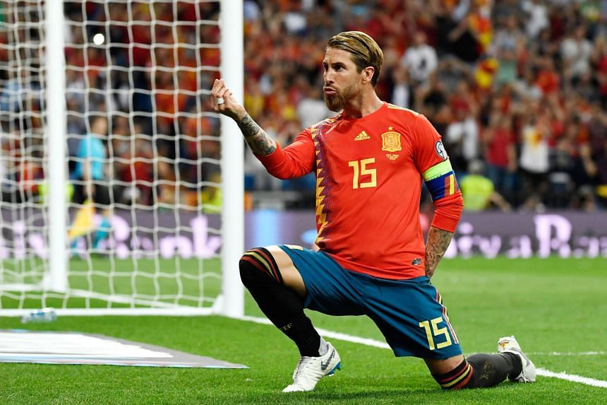 Spain's Sergio Ramos celebrates after scoring the opening goal against Sweden from the spot in their 3-0 Euro 2020 qualifying win at the Santiago Bernabeu in Madrid. The three-time champions lead Group F by five points.