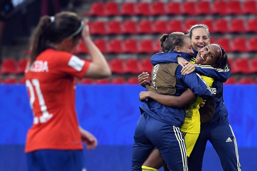 Sweden's forward Madelen Janogy (second right) is congratulated by team mates at the end of the match