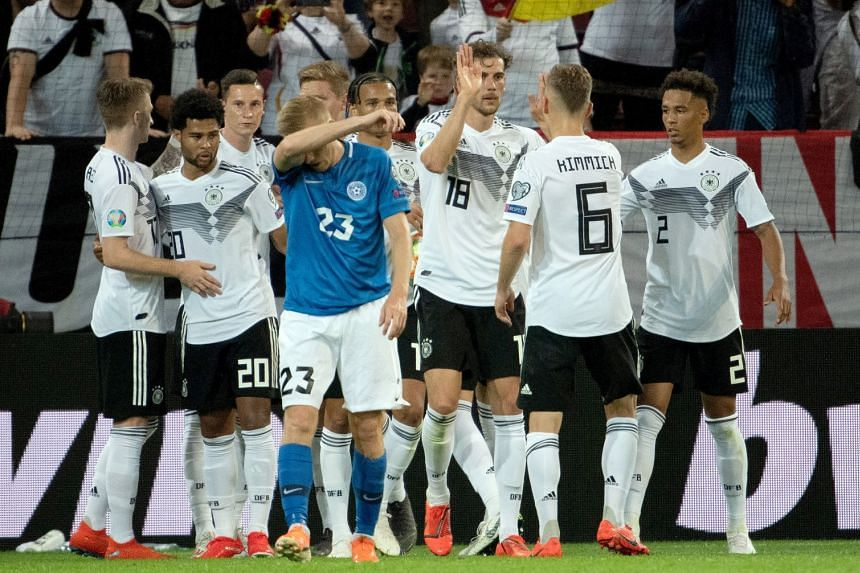 Germany's players celebrate their sixth goal scored by Serge Gnabry.