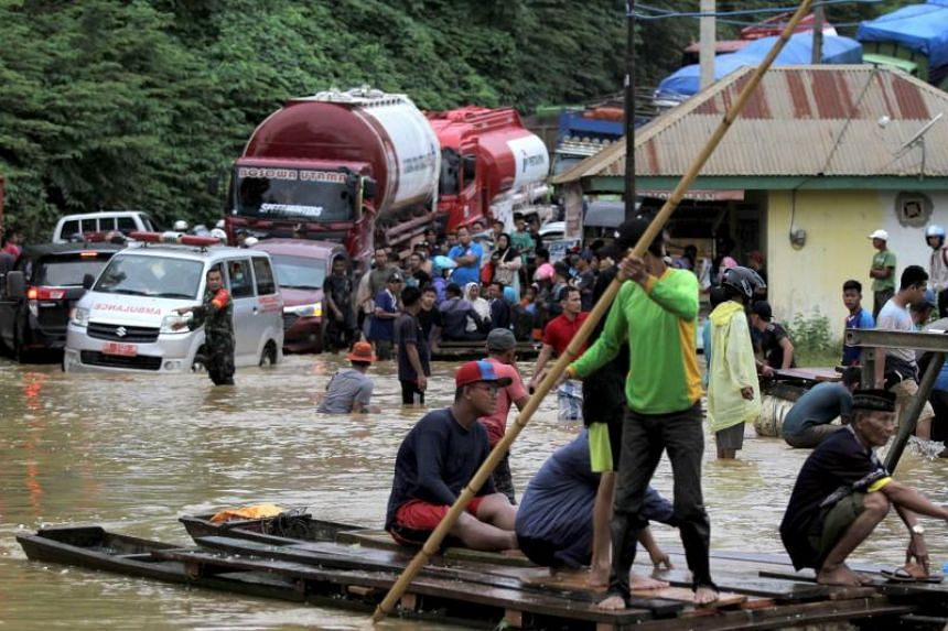 The national disaster mitigation agency said the torrential rains in the provinces of South Sulawesi, South-East Sulawesi, Central Sulawesi and East Kalimantan flooded and carried away buildings.