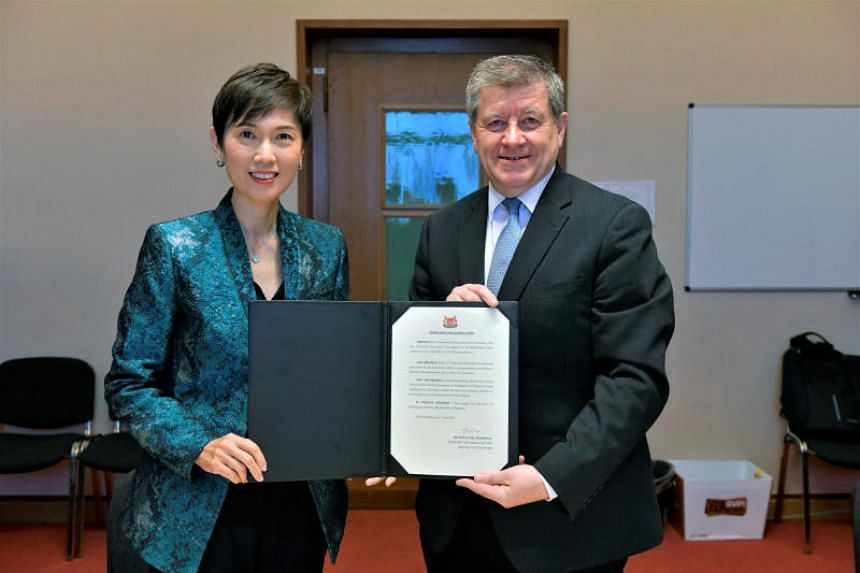 Manpower Minister Josephine Teo and International Labour Organization (ILO) director-general Guy Ryder with the instrument of ratification. Singapore has ratified the ILO's Occupational Safety and Health Convention.