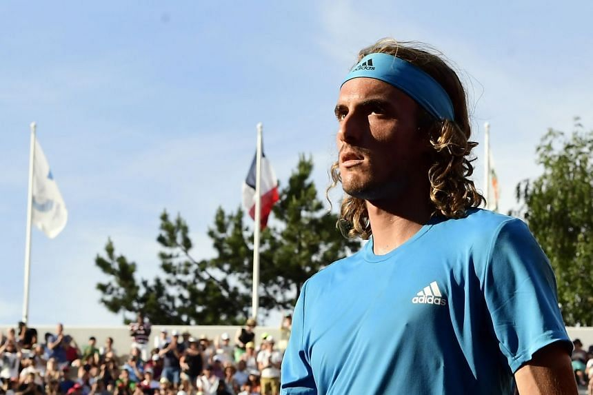 Top seed Tsitsipas (above, during the French Open) was beaten 6-4, 3-6, 6-4 by world number 60 Nicolas Jarry.