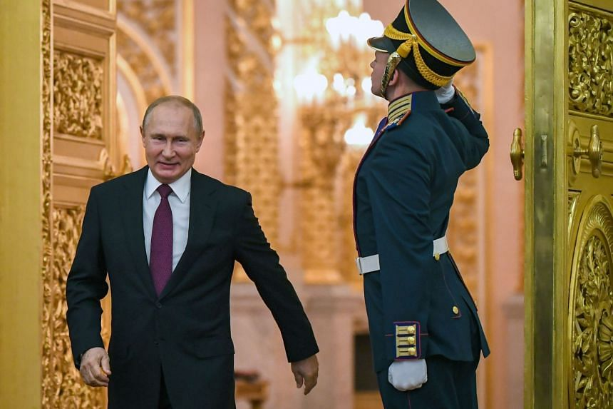 Putin (left) arrives at an awards presentation at the Grand Kremlin Palace in Moscow, June 12, 2019.