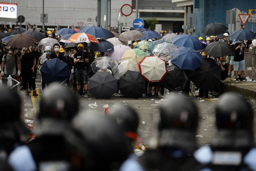 Protesters react during the rally outside the Legislative Council in Hong Kong.