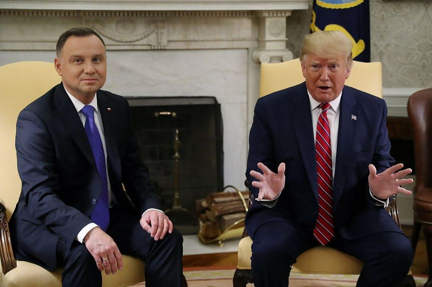 Trump speaks during a meeting with Poland's President Andrzej Duda in the Oval Office of the White House.