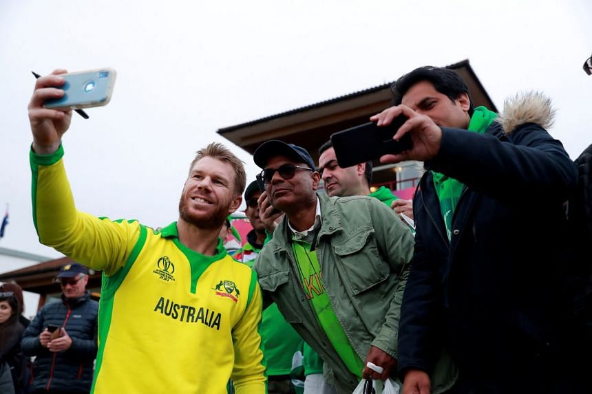 Australia's David Warner poses for a photo with Pakistan fans after the match.