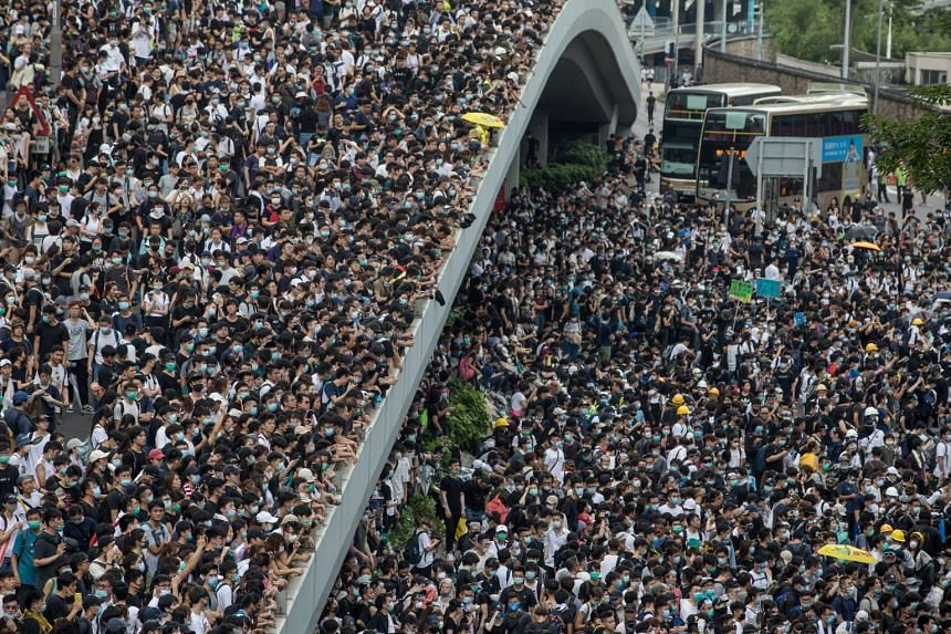 Protesters occupy a main road and walkways during the Hong Kong rally.