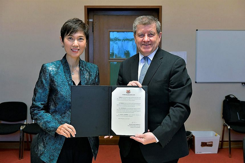 Manpower Minister Josephine Teo and International Labour Organisation director-general Guy Ryder with the instrument of ratification for the ILO's Occupational Safety and Health Convention. Singapore is the second Asean country after Vietnam to endor