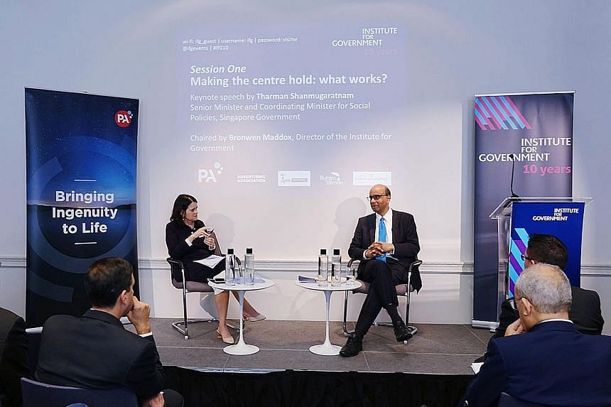 """Senior Minister Tharman Shanmugaratnam at the Institute for Government's 10th anniversary conference yesterday with its director Bronwen Maddox. He said: """"It is much harder to address the inequality or to spur social mobility if the escalator is stat"""