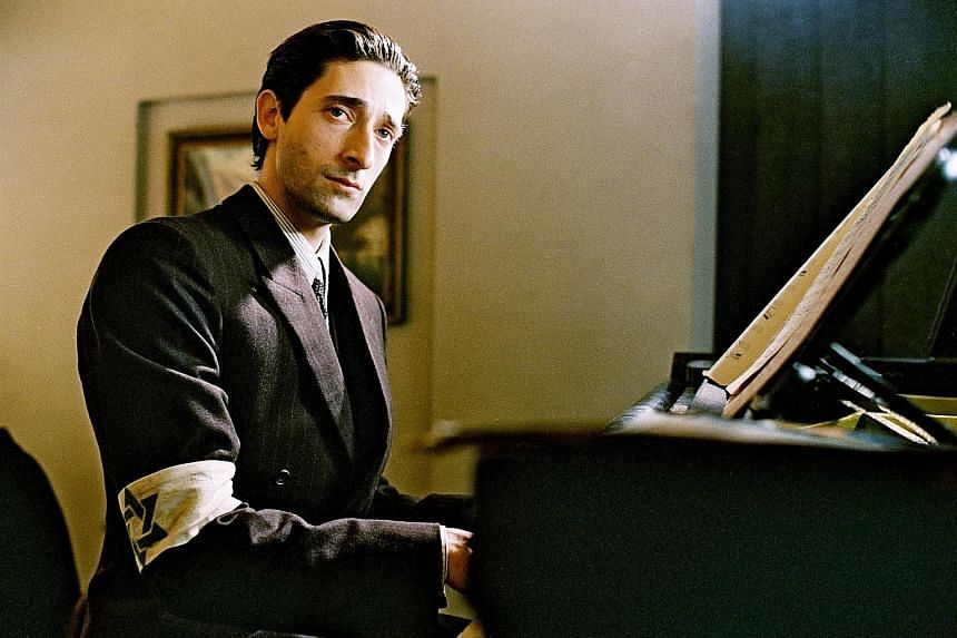 Adrien Brody plays polish concert pianist Wladyslaw Sziplman in The Pianist (2002, above), while Michael Douglas is virtuoso pianist Liberace in Behind The Candelabra (2013, left).
