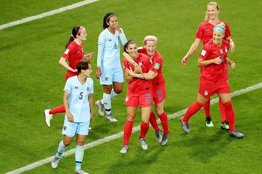 United States striker Alex Morgan (No. 13) celebrating with teammates after scoring the fifth goal in a 13-0 World Cup win over Thailand on Tuesday.