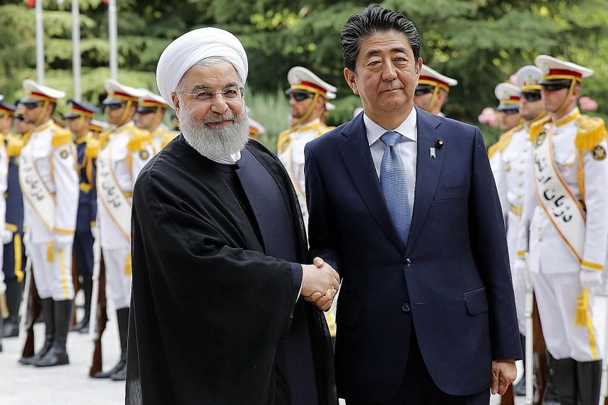 Iranian President Hassan Rouhani welcoming Japanese Prime Minister Shinzo Abe to Teheran yesterday. Mr Abe is the first Japanese leader to visit Iran since the 1979 Islamic Revolution. He will hold talks with Mr Rouhani and meet the Islamic Republic'