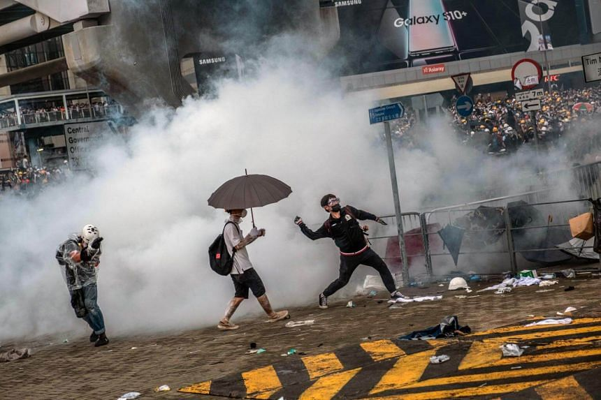 Protesters are engulfed in tear gas near the Legislative Council in Hong Kong, on June 12, 2019.