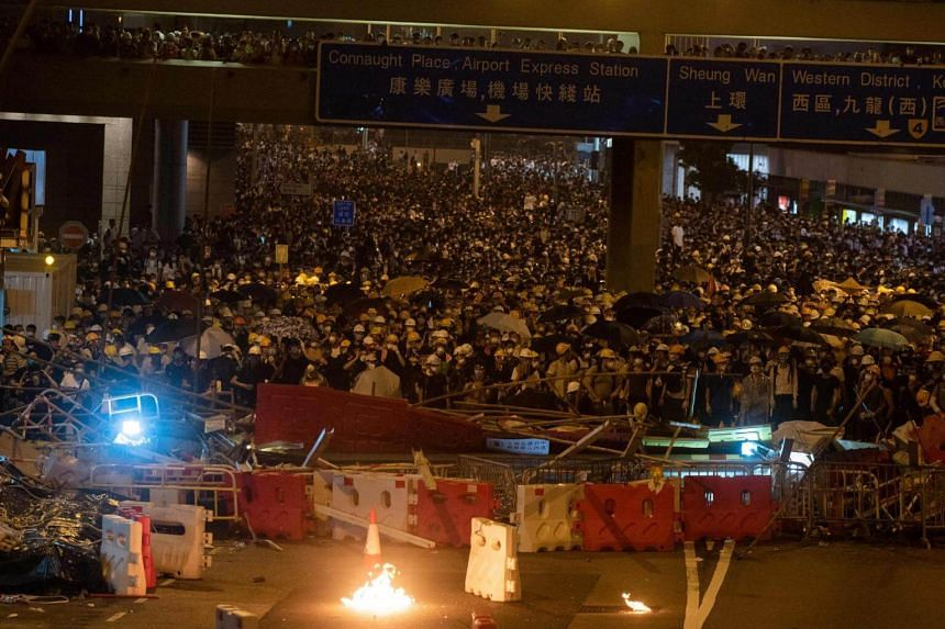Gasoline bomb (front) is seen as protesters occupy Harcourt Road in Hong Kong, on June 12, 2019.