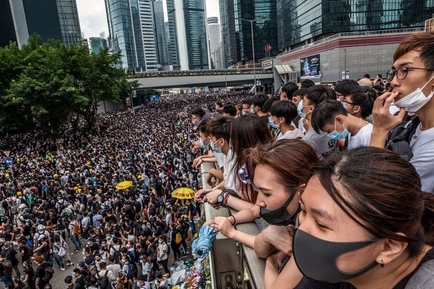 Protesters gather outside the Legislative Council in Hong Kong on June 12, 2019.