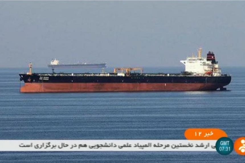 An undated picture obtained by AFP from Iranian State TV IRNN on June 13 reportedly shows the two tankers involved in an incident off the coast of Oman.