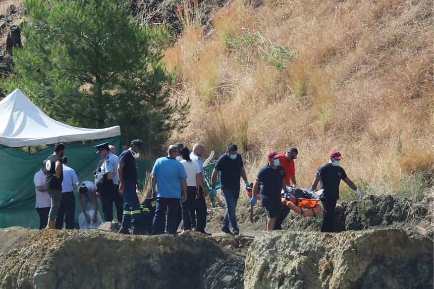 Cyprus police personnel carry a stretcher containing what is believed to be remains of a six-year-old girl, near the village of Xiliatos, Cyprus, on June 12, 2019.