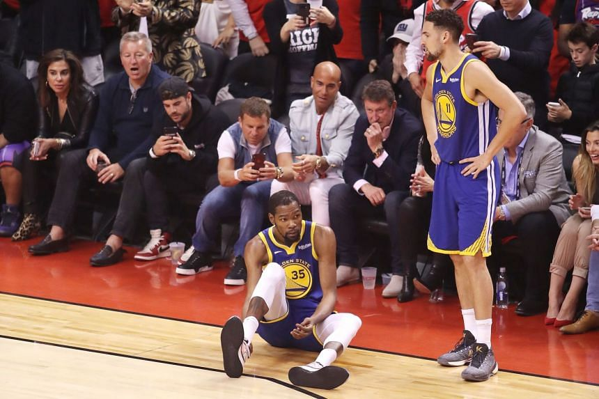 Durant reacts after sustaining an injury against the Toronto Raptors.