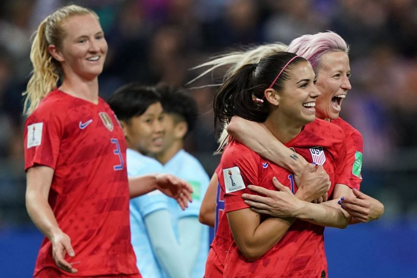 Alex Morgan (second right) and US forward Megan Rapinoe (right) celebrate a goal against Thailand.