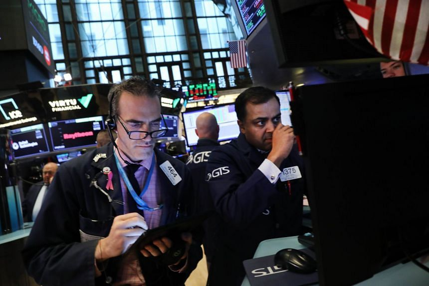 Traders work on the floor of the New York Stock Exchange on June 10, 2019.