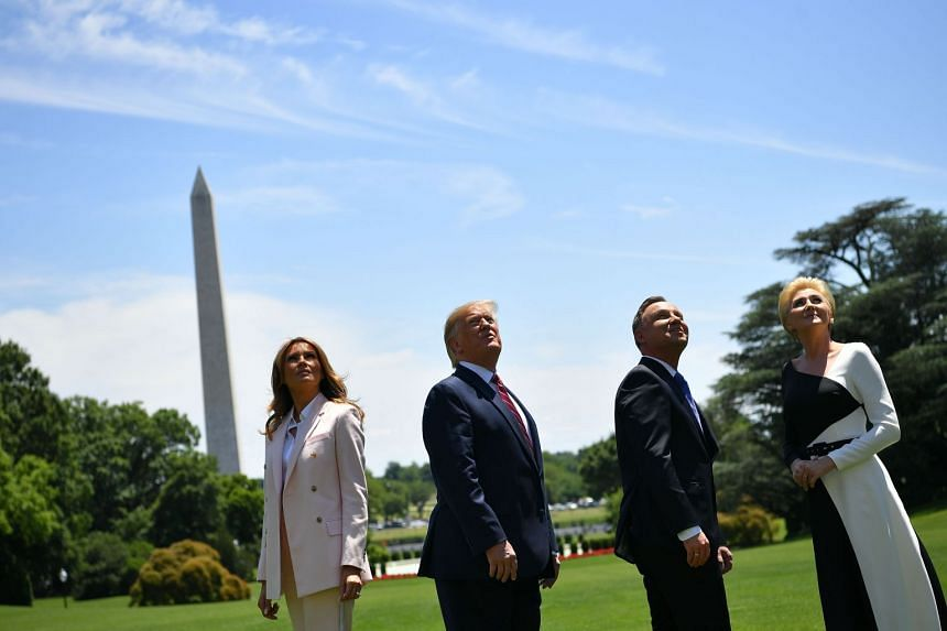 (From left) Melania and Donald Trump join Andrzej Duda and his wife Agata Kornhauser-Duda to watch F-35 fighter planes fly over the White House.